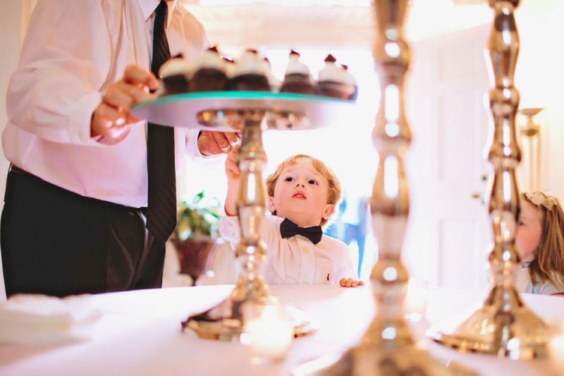 SNEAKY, SNEAKY: After serving as ring bearer, Henry Howard satisfied his sweet tooth with a mini chocolate cupcake.