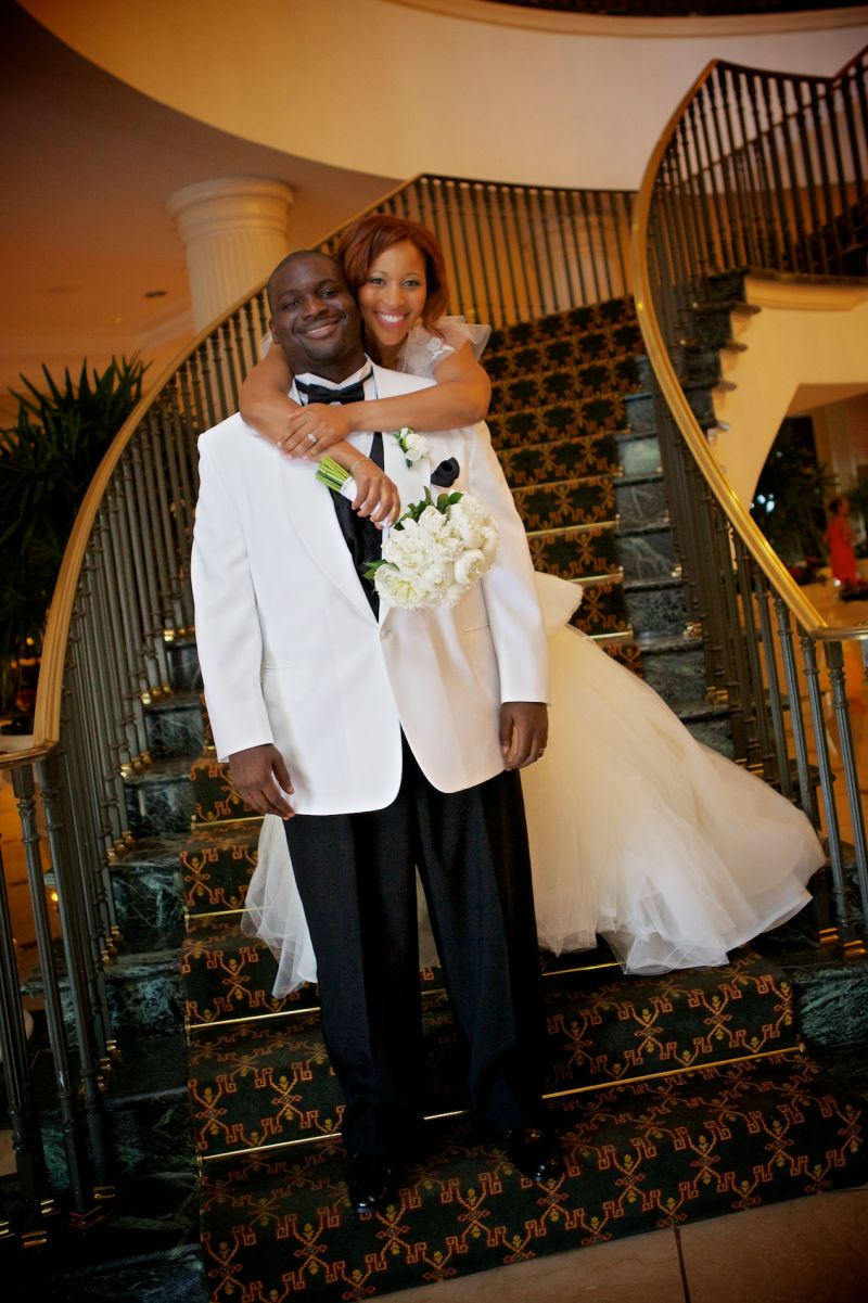 "BIG DAY BLISS: ""It was a great day that we'll never forget,"" says Richelle, posing with her husband on the grand staircase at the Charleston Place."