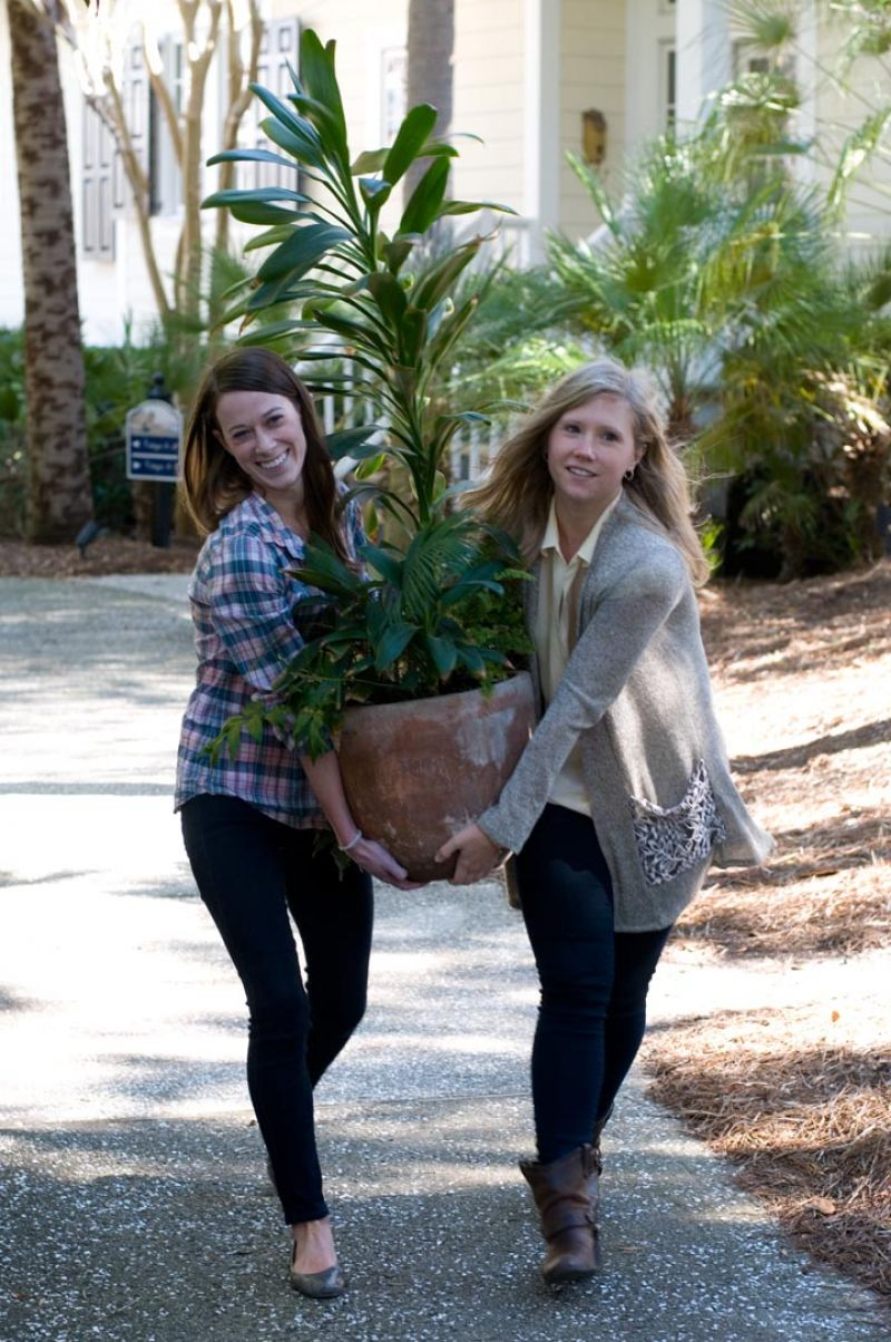 To get the opening shot for the story, we had to swap out some wintery looking planters for some evergreen ones. With the buff Daisy Bainum (Charleston Weddings intern) and Molly, the swap-out was a snap. Photograph by Taylor Horton