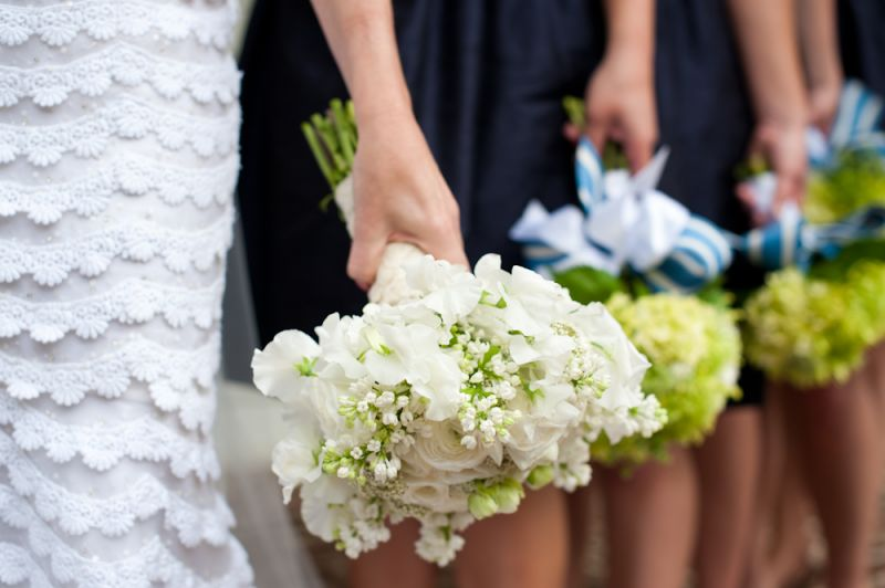 ALL IN LINE: Florist Sue Burden finished the bridesmaids' hydrangea bouquets with bright blue and white striped ribbon.