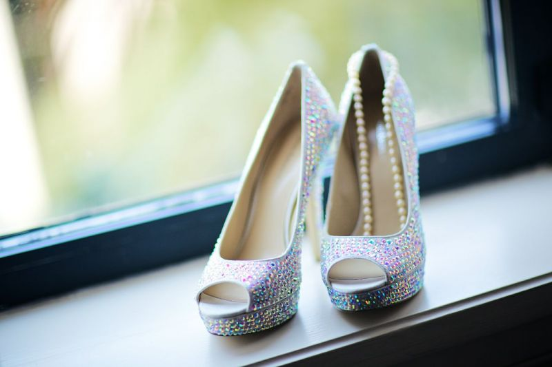 FINAL TOUCHES: For accessories, the bride donned bedazzled peep-toe pumps from Nordstrom and a simple strand of pearls.