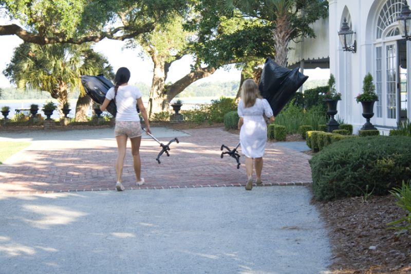 Style intern Kristy Lui and Charleston Weddings Editorial Assistant Molly Hutter carry gowns and mannequins (on loan from LulaKate) into the house at Lowndes Grove Plantation