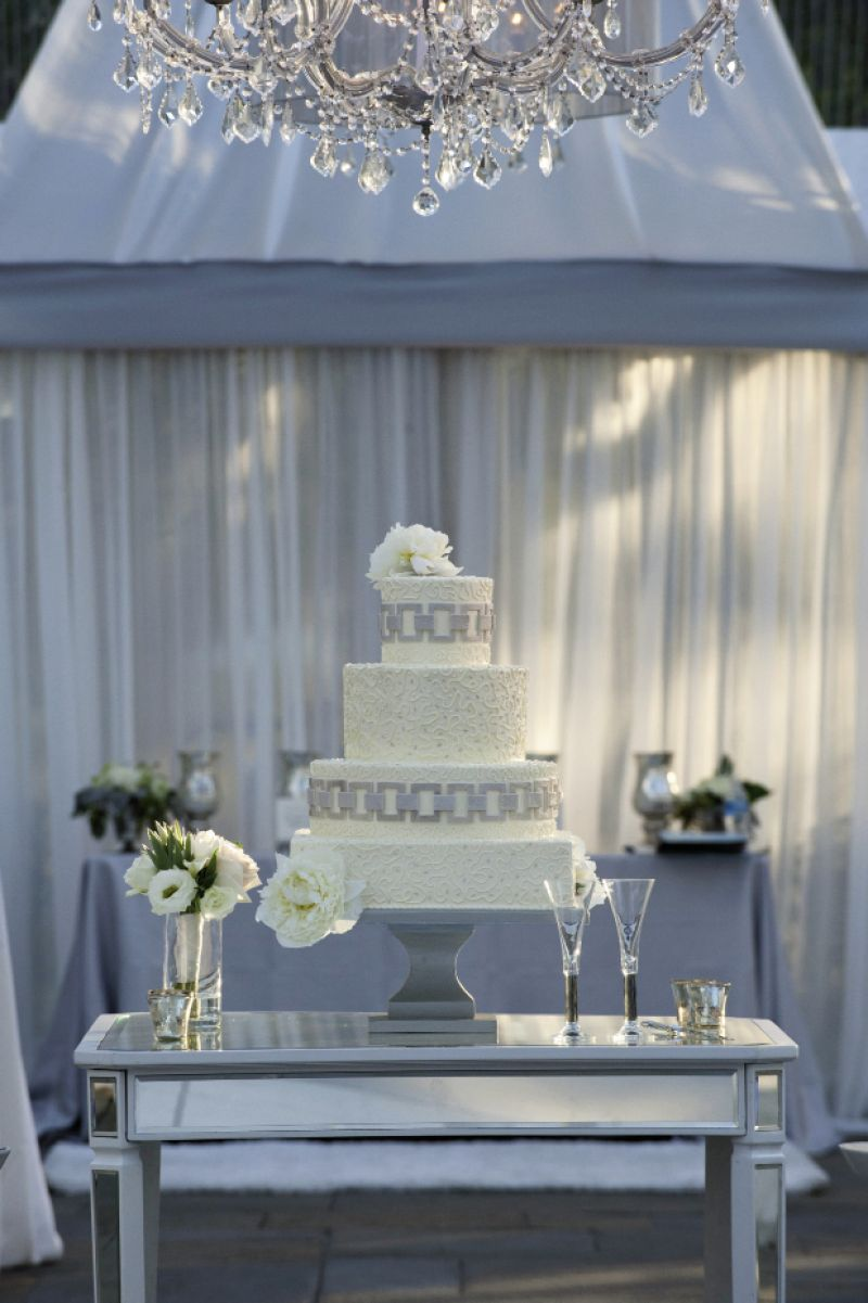 "LASTING IMPRESSION: ""From the stunning mirrored cake table and my parents' Art Deco champagne flutes to the dramatic mirrors and gorgeous chandeliers, the design was beautiful and timeless,"" says Chloe of the reception."