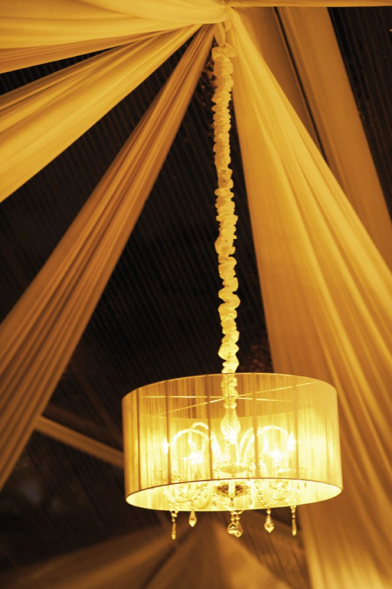HEIGHT OF STYLE: Chandeliers with drum shades cast a soft glow over the evening and served as a subtle reminder of the grand dome chandeliers that were popular in the early 1900s.