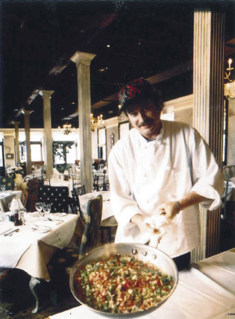 The chef with the beginning of a okra and shrimp creole in the SNOB dining room circa 1998