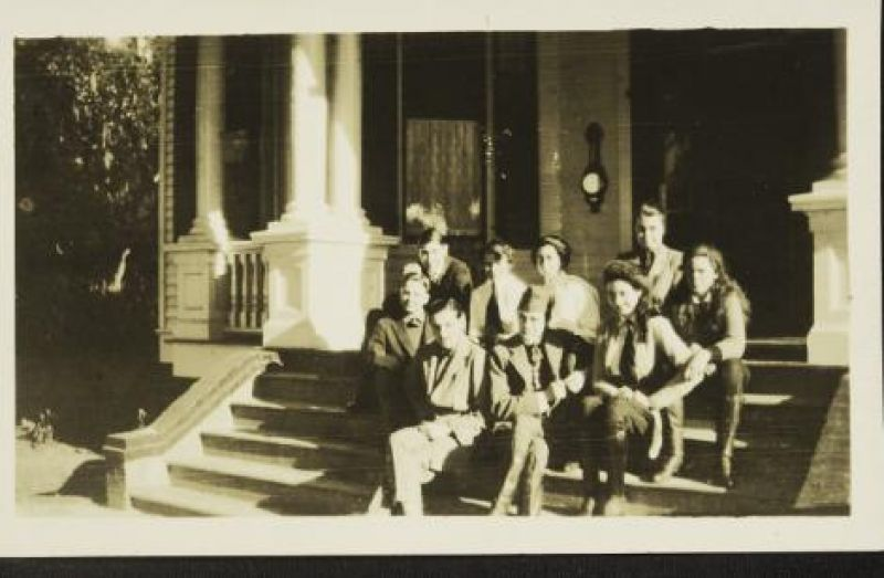 "The Baruch children and other relatives gather on the porch of ""Old Relick"" in 1918."