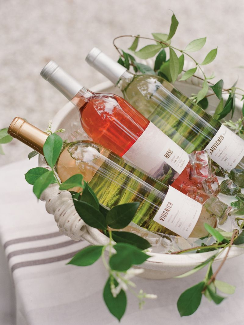 "For the ""bar,"" Lynn filled a Vietri planter with ice and just-plucked jasmine vines to chill a variety of their Pippin Hill Farm & Vineyard wines."