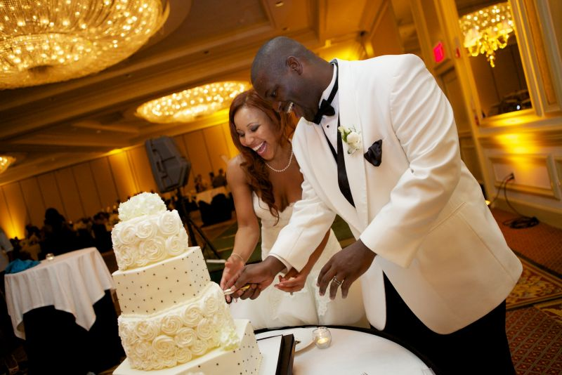 NICE SLICE: The bride and groom were all smiles cutting the cookies 'n cream cake—the bride's flavor of choice.