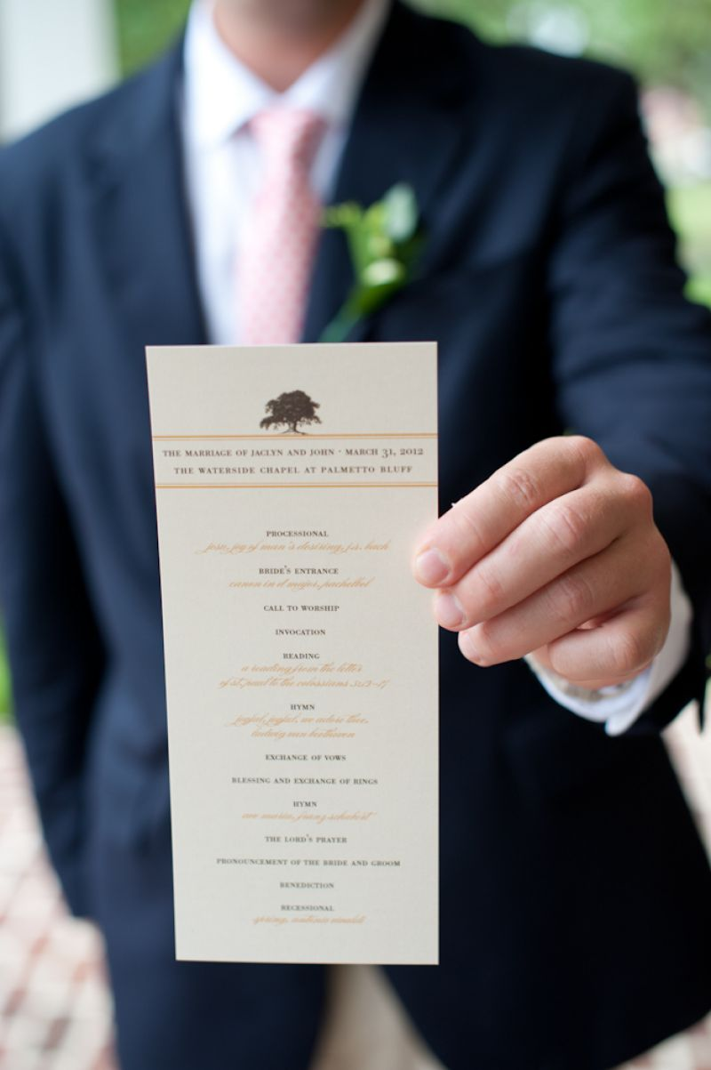 STAMP OF APPROVAL: Ceremony programs by stationer Lettered Olive were capped with an emblem of an ancient oak.