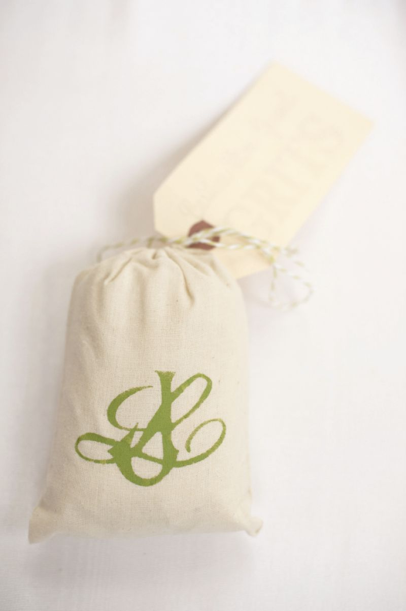 HANDIWORK: Bridesmaid Rosalyn McKoon hand-stenciled the couple's green monogram on muslin favor bags of grits.