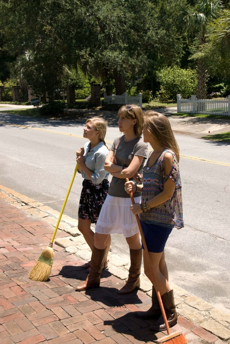 Molly Hutter (Charleston Weddings' editorial assistant), Melissa Bigner (editor), and Lizzie Gheorghita (intern) survey the church front to make sure it's ready for the shoot. We really should have staff brooms at this point for how often we're sweeping up sets…