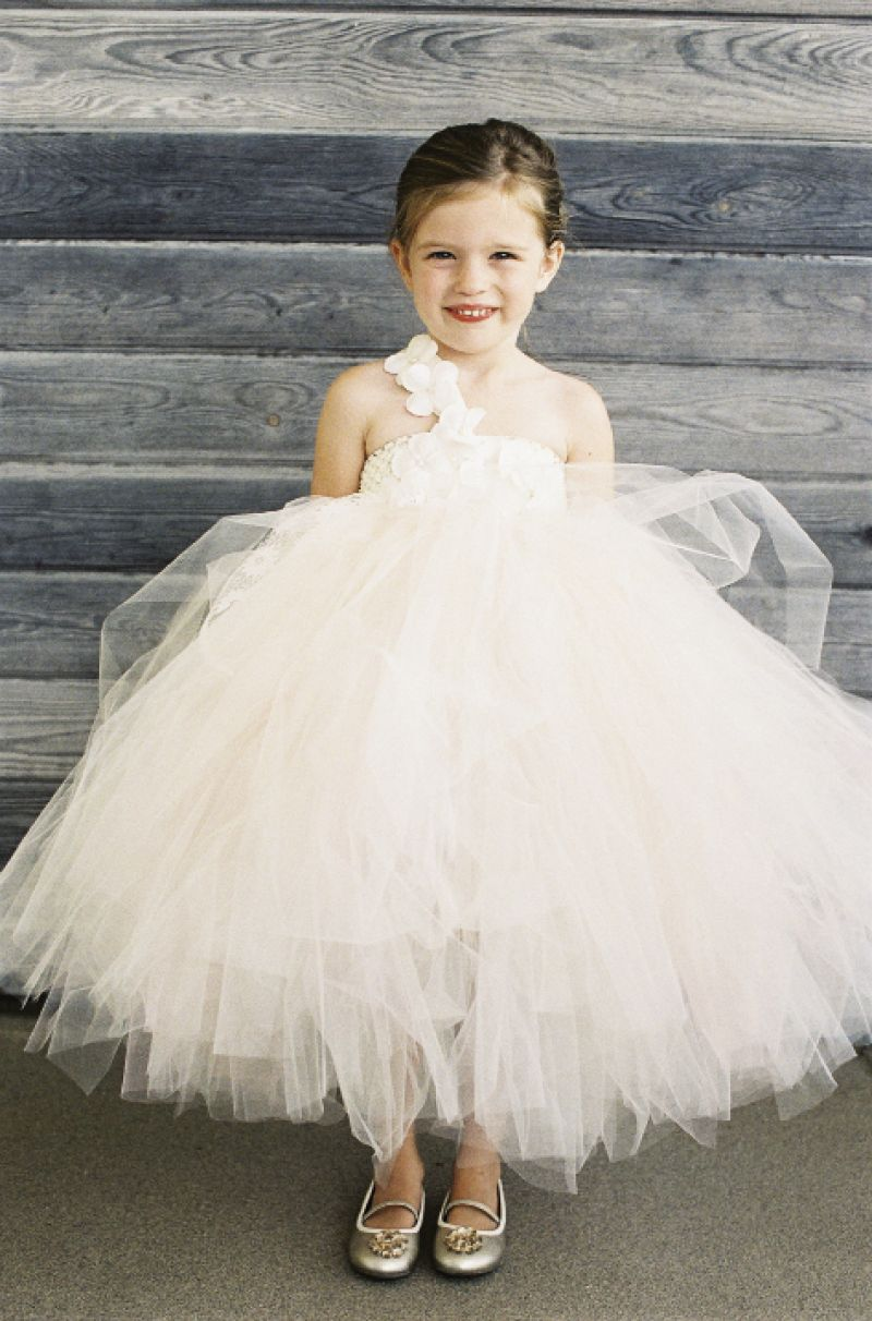 PRETTY AS A PRINCESS: Matt's niece, Avery Cate (here in a tulle frock from Laurie's Tutu Boutique), scattered petals across the aisle before the ceremony.