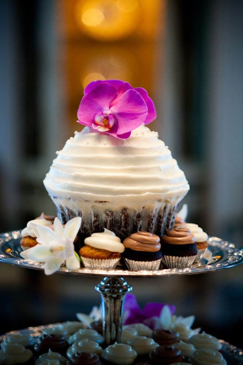 PRETTY PRESENTATION: WildFlour Pastry provided cupcakes both big and small. Accent flowers added color to the vanilla and chocolate sweets.