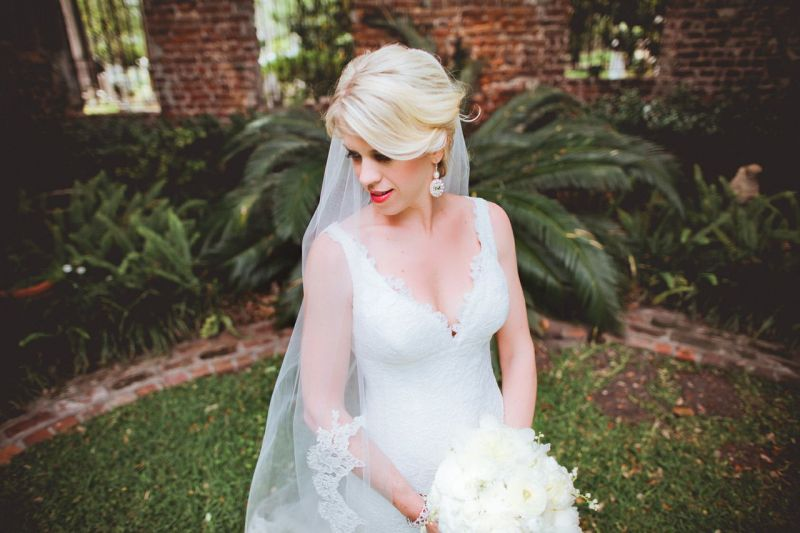 BRIDAL PORTRAIT: Loluma arranged an all-white bouquet to complement Allison's Romona Keveza gown.