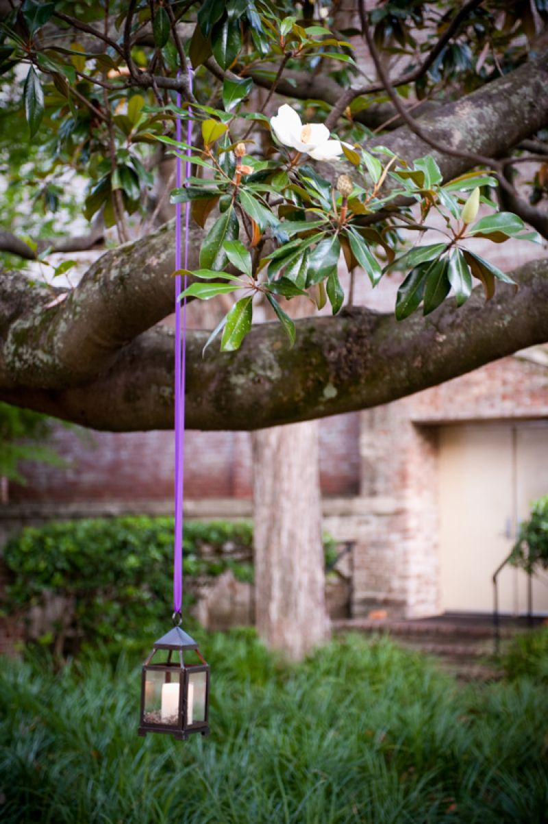 HANGING AROUND: After the sun had set, lanterns—tied with signature purple ribbon—helped light the backyard of the William Aiken House.