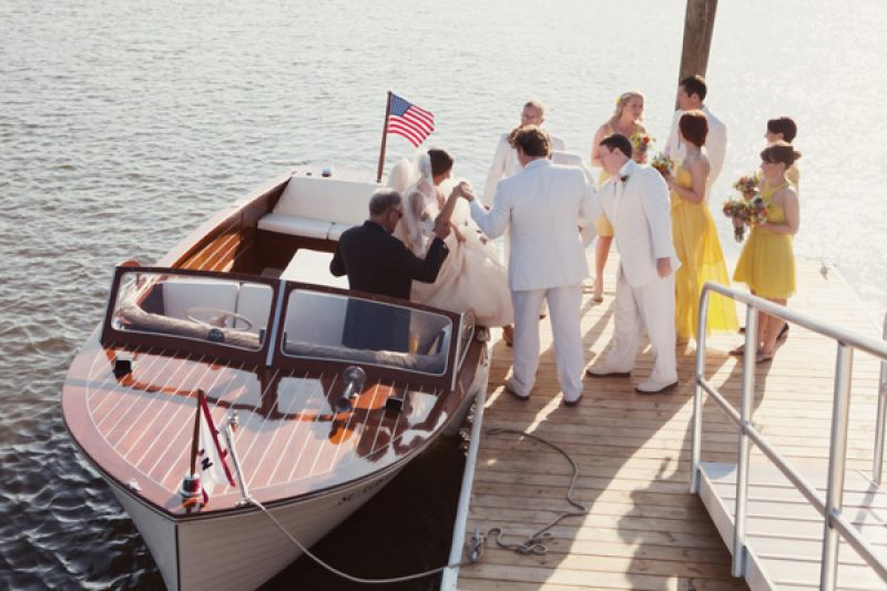 DOCKSIDE DELIGHT: Lindsey's journey to the altar was nothing short of adventurous, gracefully exiting the boat with the help of groomsmen.