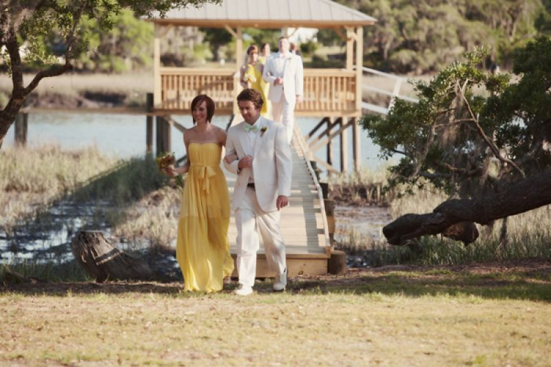 GRAND ENTRANCE: The wedding party led the procession from the dock to the altar.