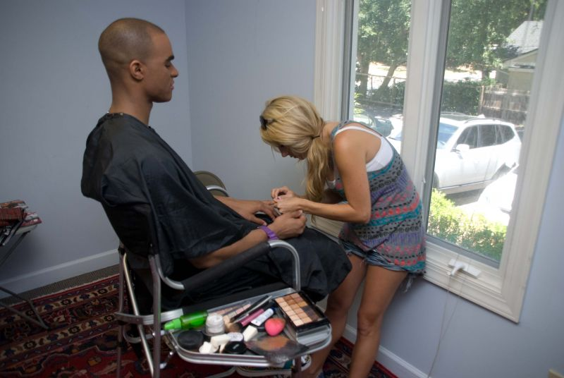 Hair and makeup stylist Ashley Brook Perryman grooms Caesar for the camera, which basically entailed filing his nails and evening out his complexion. Guys really do have it easier…especially when the guy's a camera-ready model.