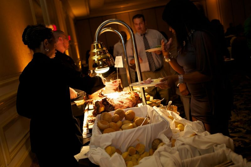 "DISHING IT OUT: The Charleston Place hotel catered the reception feast, which included various stations like this carving table. The bride's one regret of the night? ""We would have eaten more of our amazing food that was being served during the reception!"" says Richelle."