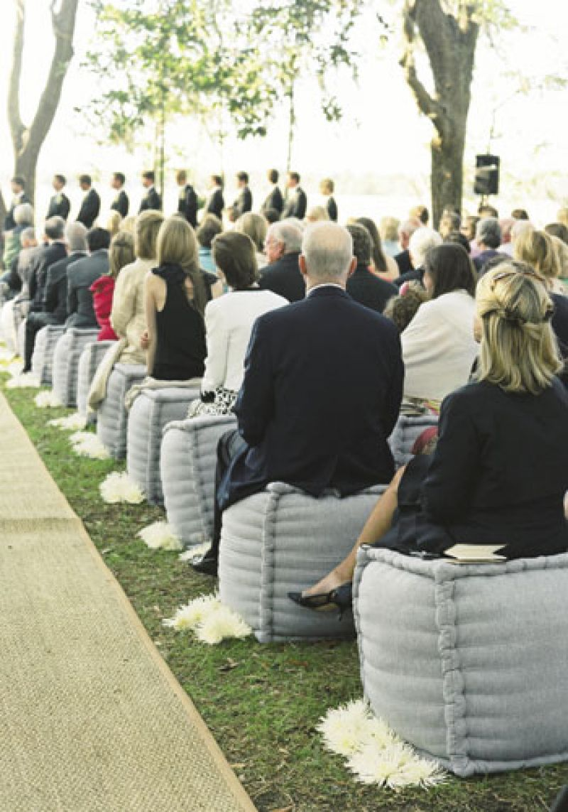 Soft Spot : Guests witnessed the vows from linen ottomans.