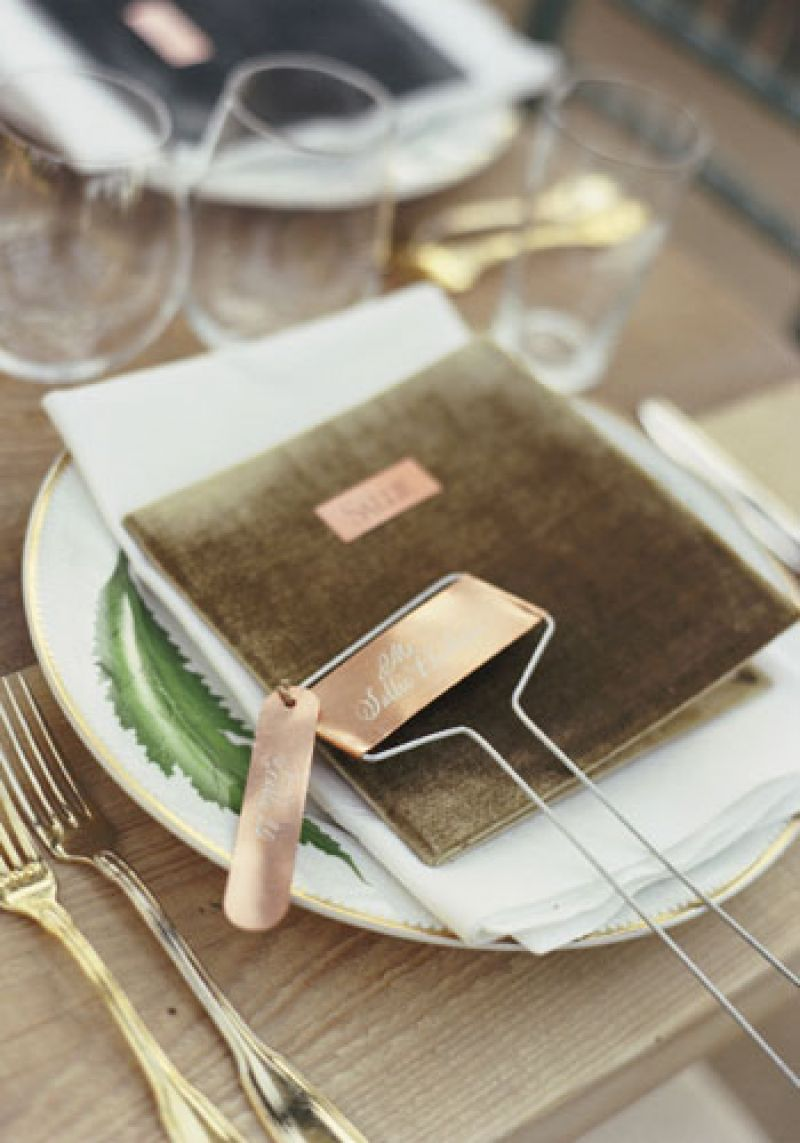 "Luxe Appointment: ""We wanted an old-school restaurant feel for the menu book,"" says Tara of the handcrafted velvet menus. Copper butler cards were engraved with guests' names."