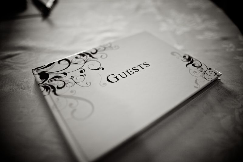 BE OUR GUEST: Fitting for the traditional tone of the evening, the guestbook was simple and classic.