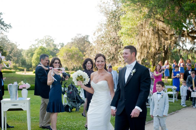 HAND-IN-HAND: The bride and groom retreat up the aisle through the Octagonal Garden.