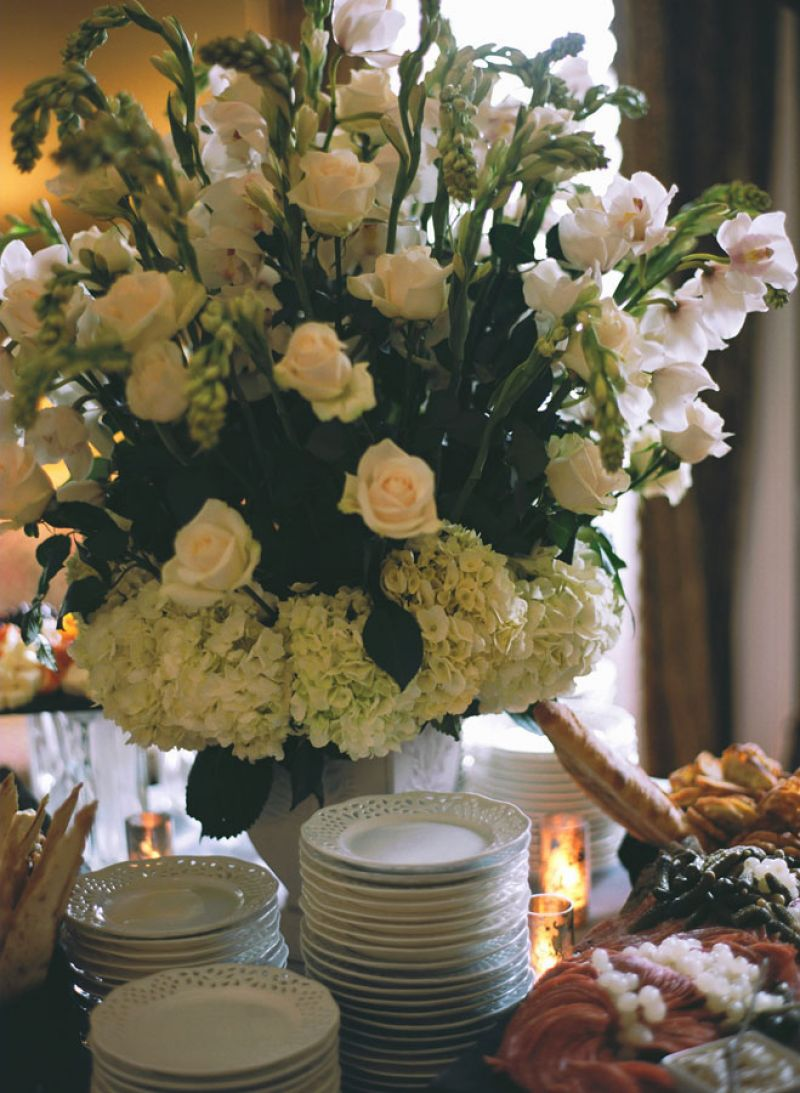 "FEAST FOR THE AGES: Sara says she and Dominick wanted the reception to convey an ""old world,"" traditional feel, which a charcuterie spread and grand florals helped to create."