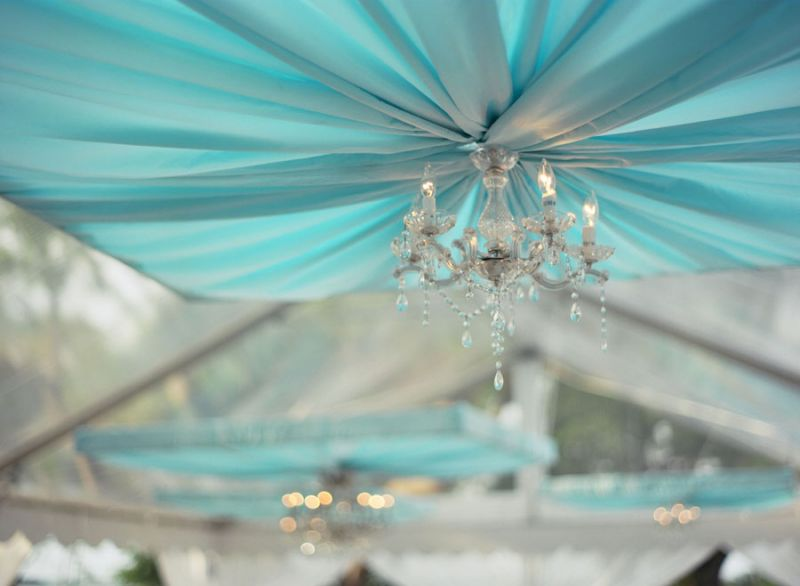 CRYSTAL CLEAR: Chandeliers gave a shimmering finish to the dinner tent top's panels of ruched chiffon.