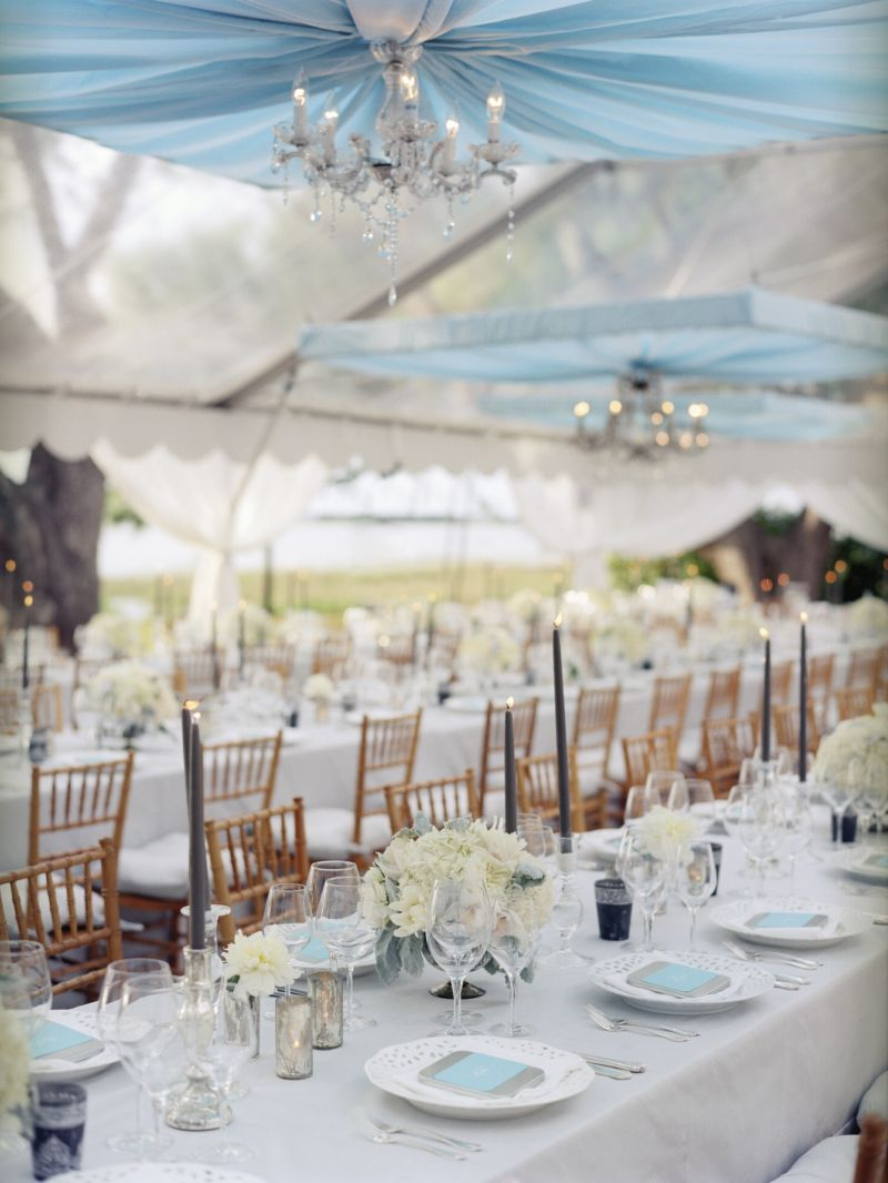 LET'S DO DINNER:  Unfussy place settings and pale-hued arrangements lent understated charm to the long tabletops, which were framed by textured Chiavari chairs.