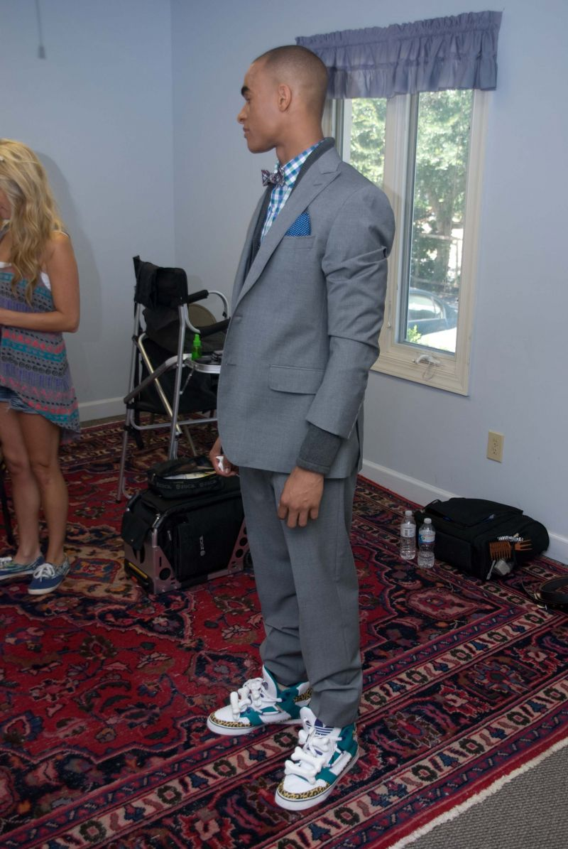 "Caesar sports ""JS Bones,"" Jeremy Scott's adidas Orginals—quite the statement shoes with his suit."