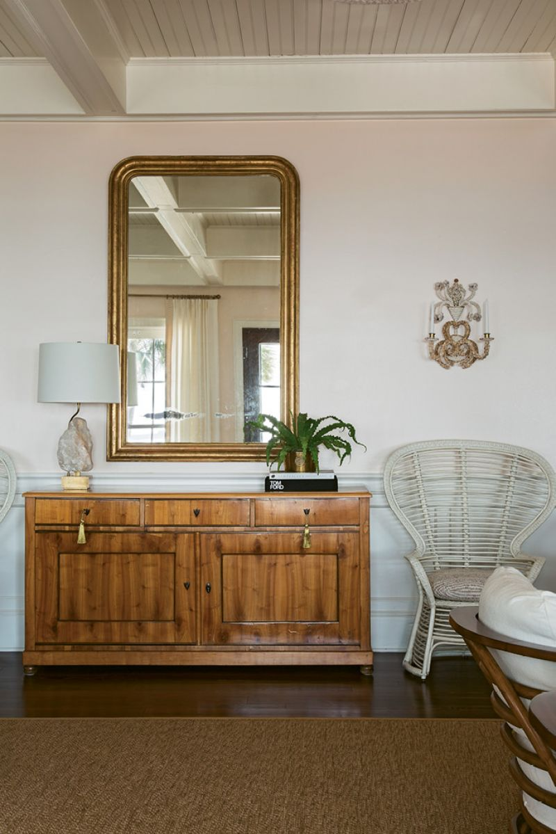 NATURAL ACCENTS: The use of natural materials, such as sisal area rugs and the cherrywood of the circa-1825 Biedermeier chest, underscore the home's connection with nature.