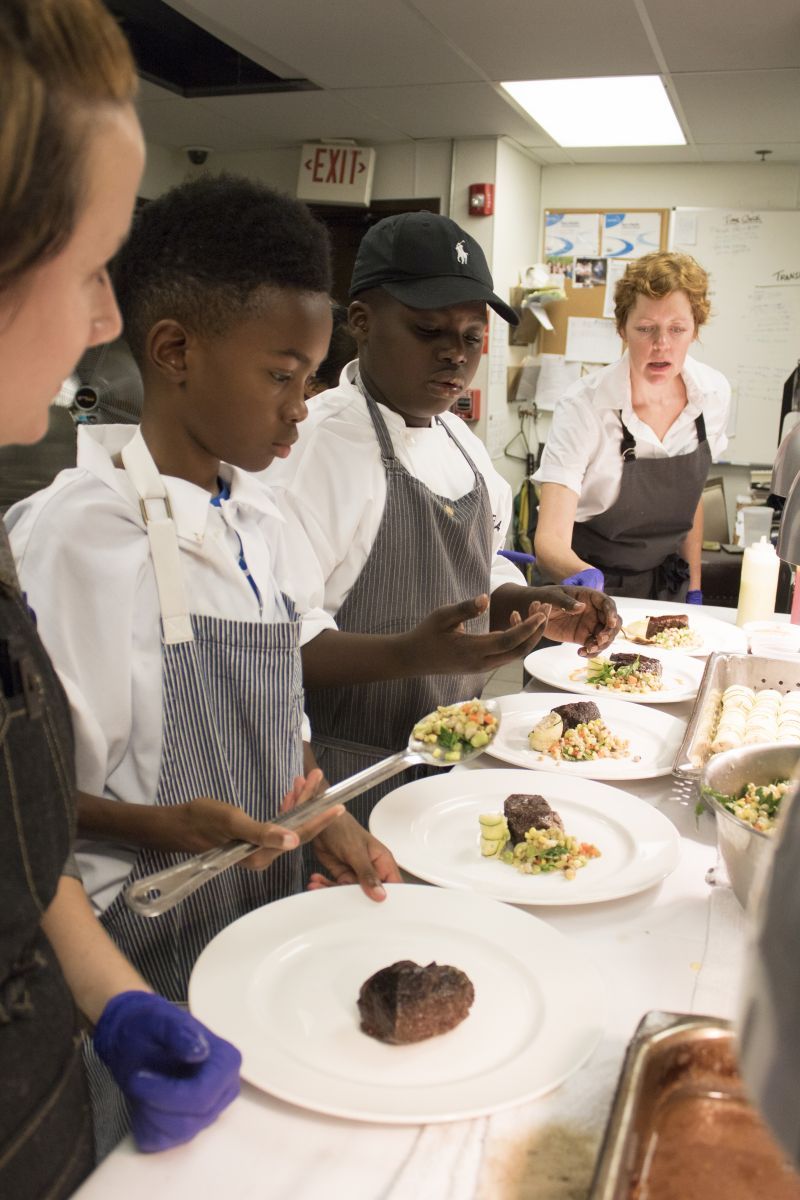 Robyn Fusto, Jaylen Jones, Jeremiah Venning, and Jill Mathias plate the fourth course.