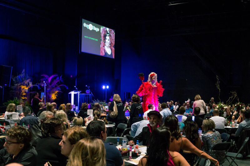 Patti O'Furniture greeting the crowd of costumed bingo players.