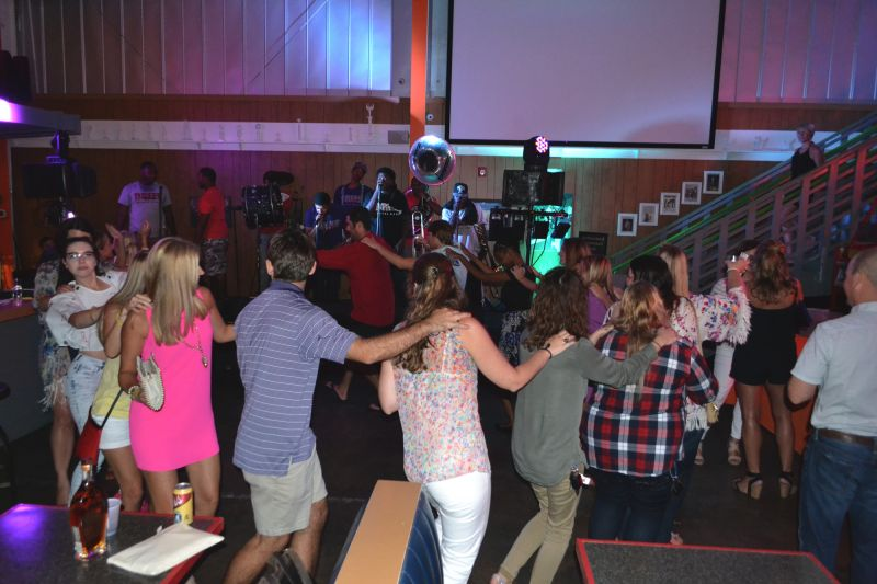 The dance floor was full of energy as a conga line circled around the event in swinging motion.