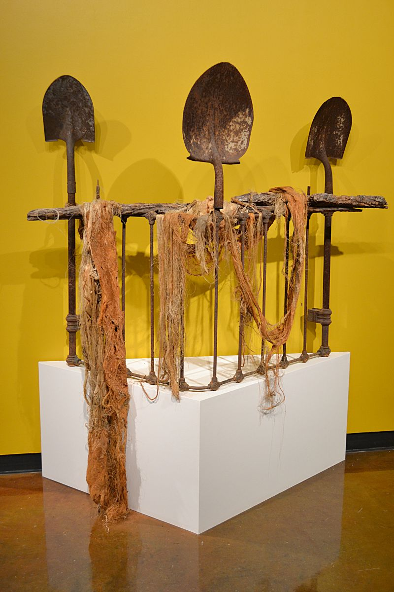 "The opening artwork to Holley's exhibit, ""Three Shovels to Bury You"""