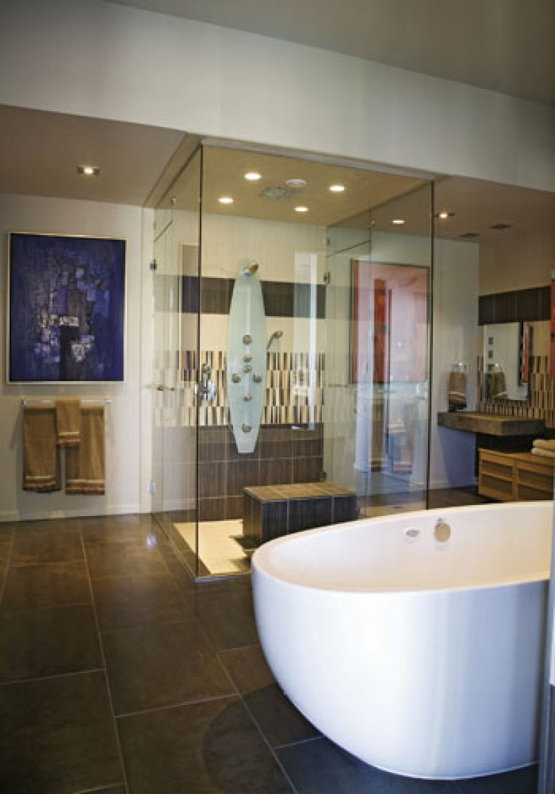 At Ease: The master bath features a soaking tub and a pair of Bertha Schwartz paintings