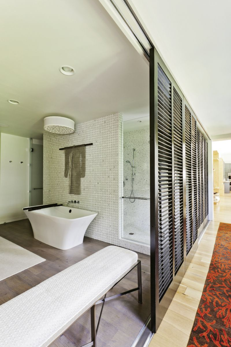 """A sculpture by Tanya Lyons was an unexpected addition to the master bath. """"It works perfectly, like she just threw her kimono over that bar, but it's stainless steel,"""" Sanchez says."""