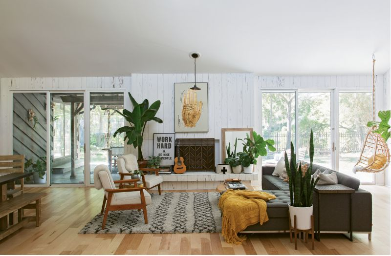 """COLOR STORY: To keep the home feeling cohesive, Erin stuck to an edited palette and used only three paint colors, all by Valspar. The interior walls were """"hosed down"""" with """"Ultra White Base A."""""""