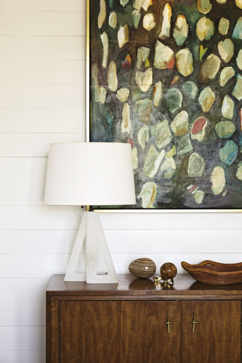 "Before she met Cortney Bishop, Lynne Hamontree was shy about hanging her own works. Now she enjoys being surrounded by her art. This oyster-shell painting, displayed in the upstairs dining area, is perhaps her favorite. ""It's the one painting I'd never sell,"" she says."