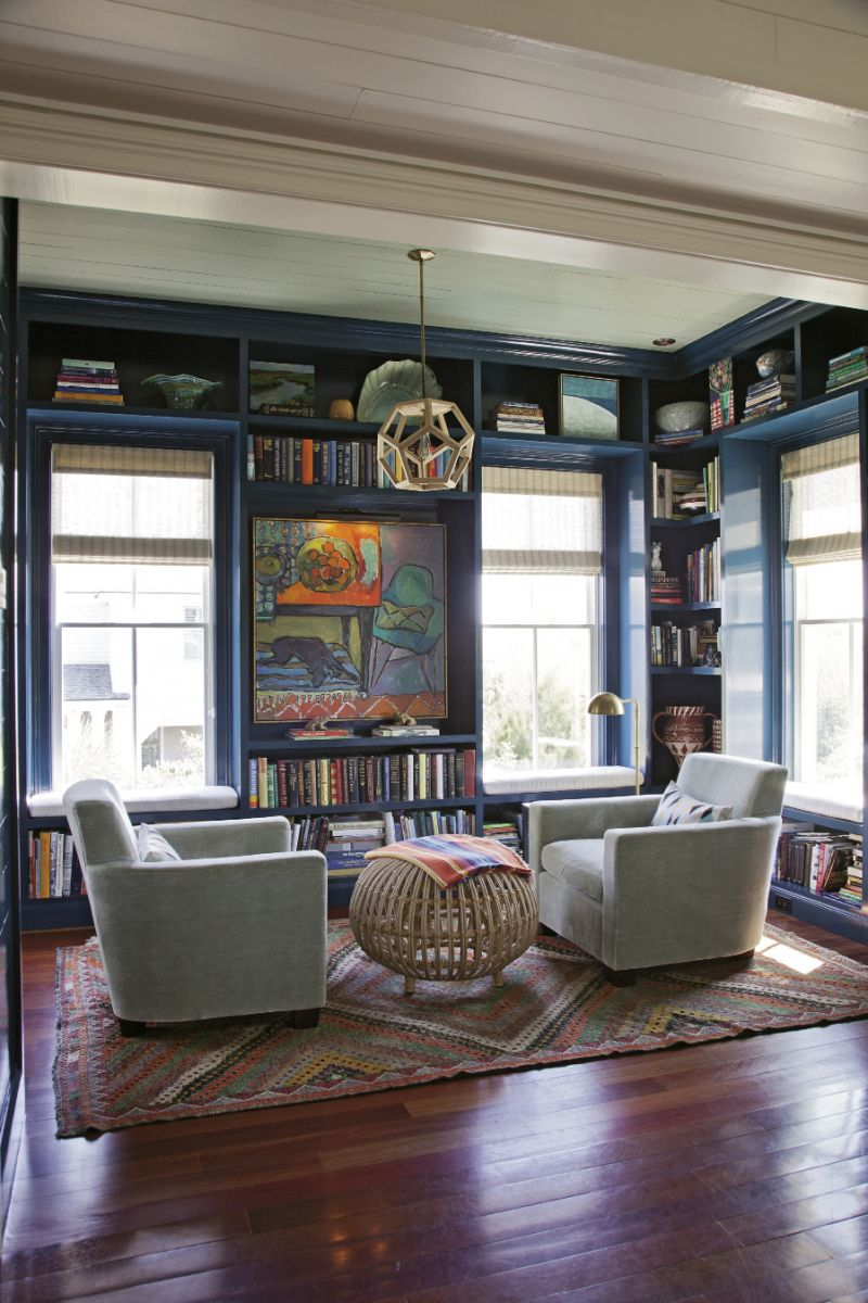 In this cozy reading nook off the kitchen, Bishop designed the built-in shelves, which were  constructed by area builder James Meadors. She also choose the paint color, a shade of blue that matches the deep waters of the sea.