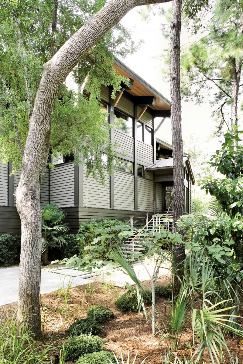 hingled siding on the street- facing exterior of Kathleen Parramore and Steve Sinn's modern dwelling helps integrate it