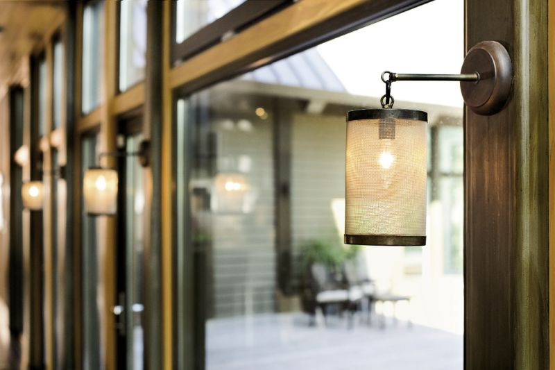 Hand-forged Italian lanterns warm the rear wall of windows.