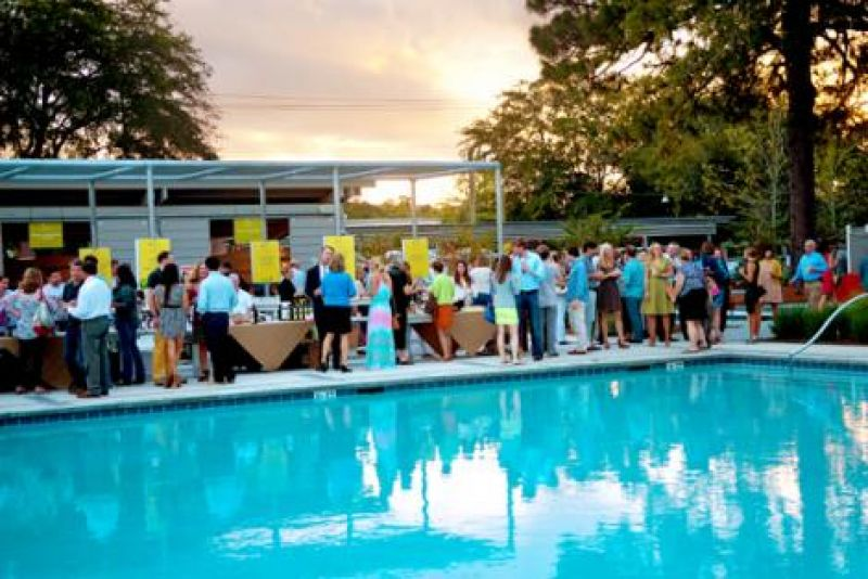 Guests mingled on the pool deck of the Mixson Bath and Racquet Club
