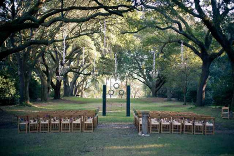 OPEN-DOOR POLICY: The backdrop for the ceremony—a 10-foot historic iron gate and two old green shutters—was custom-made by the bride's uncle, Ron Rader of Antebellum Restoration in Prosperity, South Carolina.