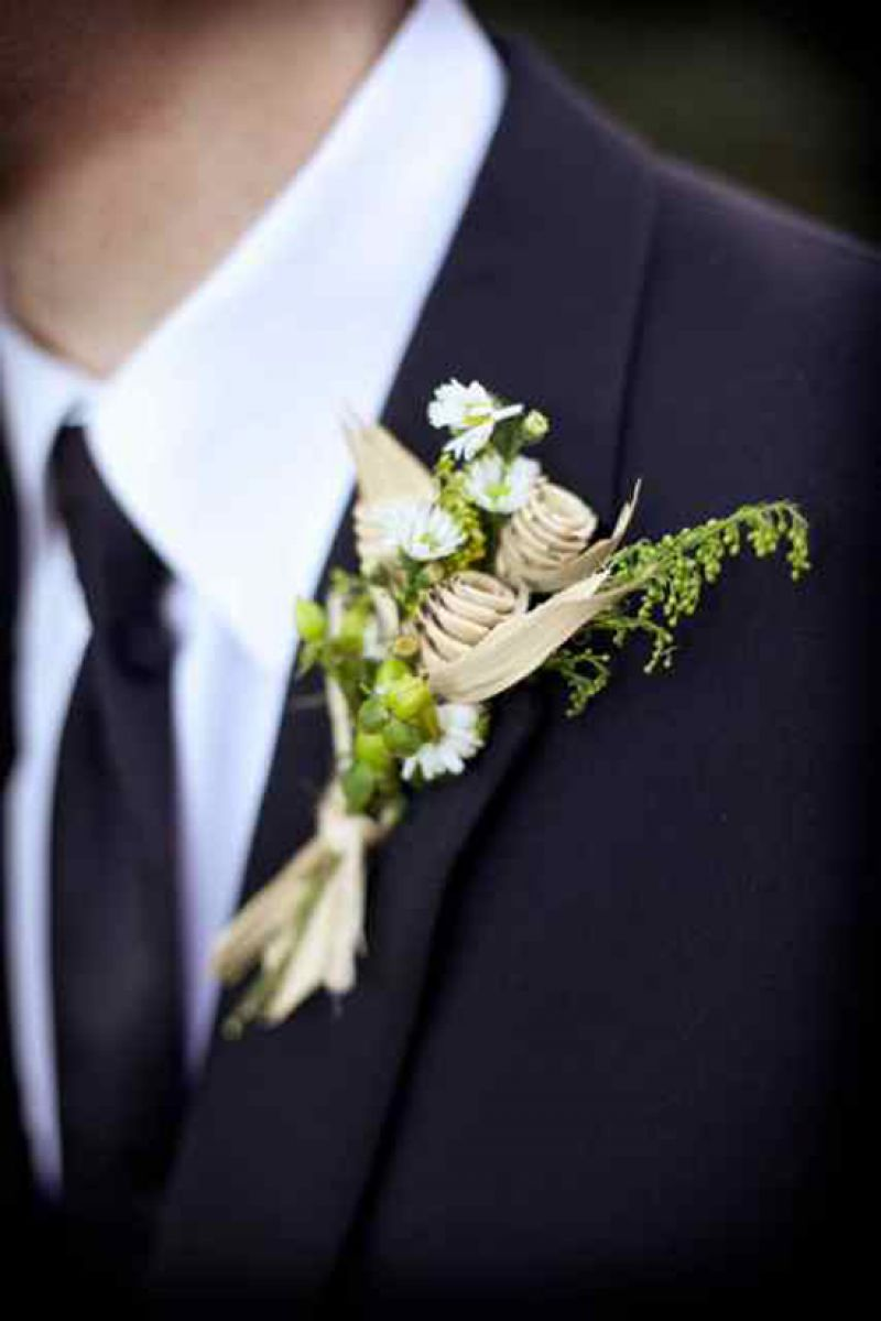 PERFECT MATCH: With a delicate mix of daisies, Monte Casinos, and sweet grass roses, the groom's boutonniere mirrored the bride's bouquet. The special significance of the daisy? Not only is it Catherine's favorite flower, but Zack says he often gifts bouquets of the posy to his girl.