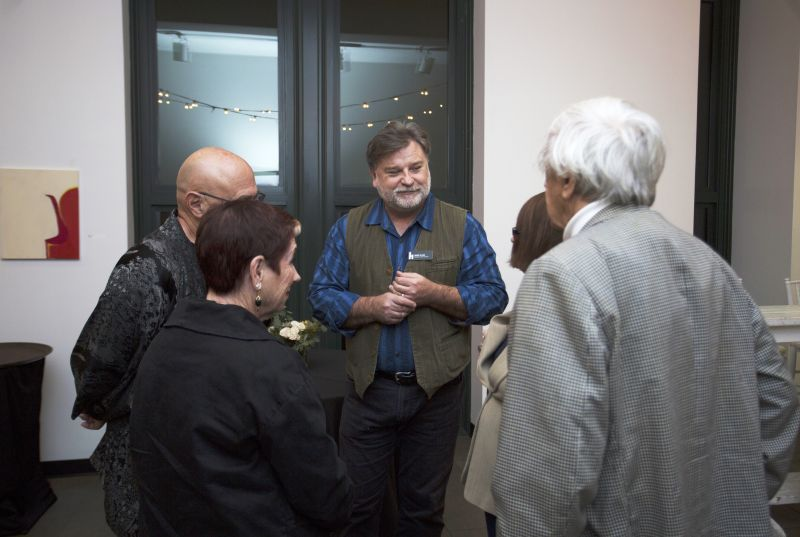 Halsey director and chief curator Mark Sloan chatting with guests