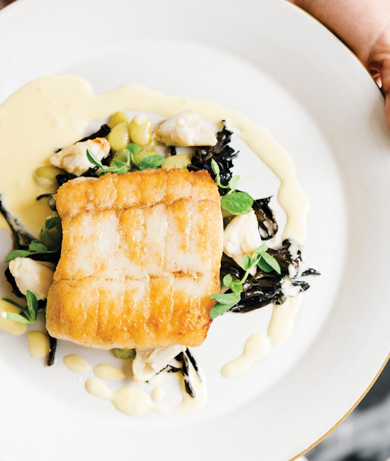 Seared to Perfection:  Flounder Pontchartrain served with chanterelles, blue crab, local legumes, and a sabayon sauce