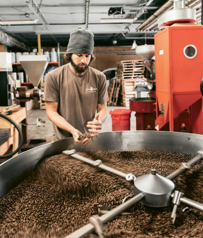 The Daily Grind: At King Bean's North Charleston facility, head roaster Richie Young and assistant Andrew Hayden roast green coffee beans on a 60-kilo Petrocini, monitoring color, temperature, fragrance, and cracking sounds