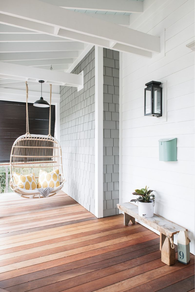 """""""I love that the design is modern yet has a vintage appeal about it,"""" says Melissa about the rattan porch"""